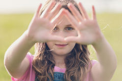 girl-looking-triangle-shape-her-hands-focus-green-eye-45451700